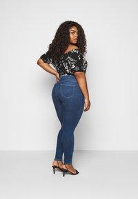 JUNAROSE - by VERO MODA - JRFOUR - Slim fit jeans - medium blue denim - 2