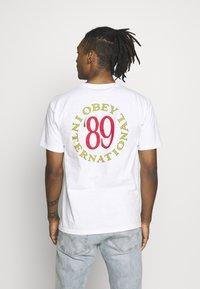 Obey Clothing - INTERNATIONAL - T-shirts print - white - 2