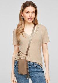 s.Oliver - Across body bag - beige - 1