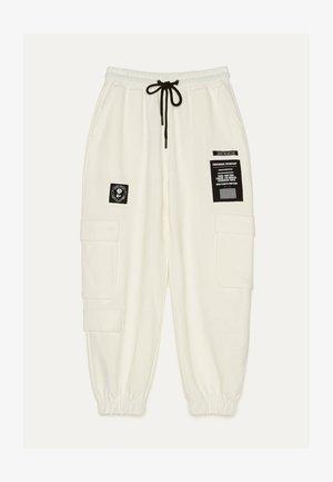 IM CARGOSTIL AUS PLÜSCHGEWEBE  - Pantalon de survêtement - beige