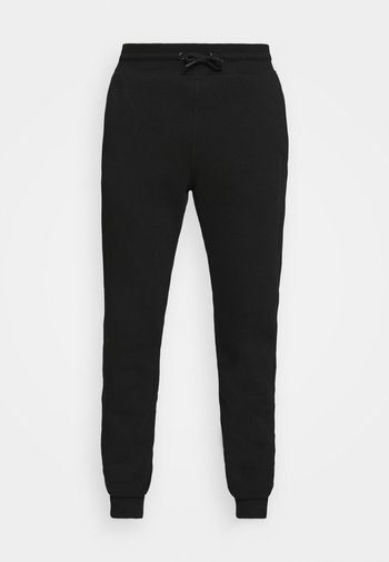ONEGRY - Tracksuit bottoms - black