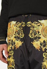 Versace Jeans Couture - PRINT BAROQUE - Tracksuit bottoms - black - 4