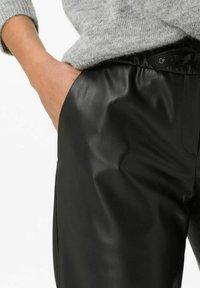 BRAX - STYLE MAINE S - Trousers - black - 4