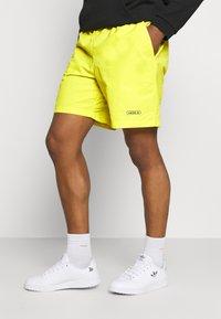 adidas Originals - WOVEN UNISEX - Shorts - acid yellow - 0