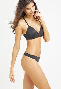 Calvin Klein Underwear - PERFECTLY FIT - String - black - 1