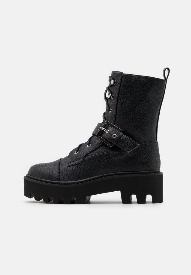 BUCKLED COMBAT BOOTS - Nauhalliset nilkkurit - black