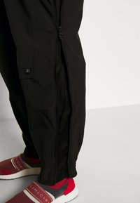 adidas by Stella McCartney - Outdoor trousers - black - 4