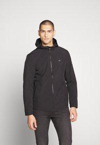 Calvin Klein - CRINKLE HOODED WINDCHEATER - Summer jacket - black - 0