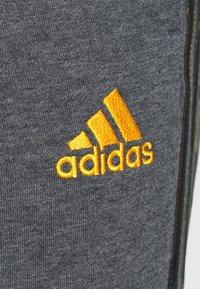 adidas Performance - CAMO - Tracksuit bottoms - dark grey heather/semi solar gold - 4