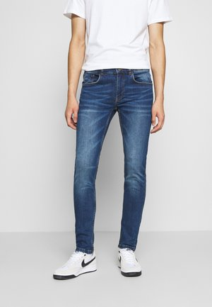 STOCKHOLM - Slim fit jeans - jet blue