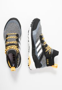adidas Performance - TERREX FREE PARLEY - Hiking shoes - core black/footwear white/solar gold - 1