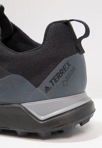 adidas Performance - TERREX CMTK GORE TEX - Trail running shoes - core black/grey three - 5