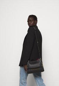 Love Moschino - BORSA SMOOTH - Handbag - black - 0