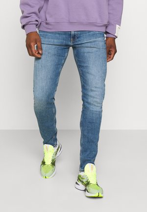 SLIM TAPER - Jeans Tapered Fit - denim medium