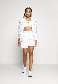 adidas Performance - PRIMEGREEN BASKETBALL SHORTS - Sports shorts - white - 1