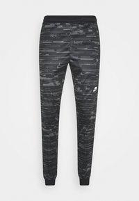 Nike Sportswear - Tracksuit bottoms - black/iron grey - 3