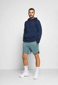Under Armour - TRAINING SHORTS - Pantalón corto de deporte - lichen blue - 1