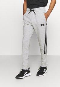 adidas Performance - 3 STRIPES FUTURE - Tracksuit bottoms - medium grey heather - 0