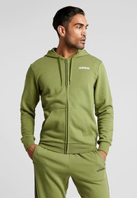 adidas Performance - ESSENTIALS SPORTS HOODED TRACK - Mikina na zip - tech olive - 0