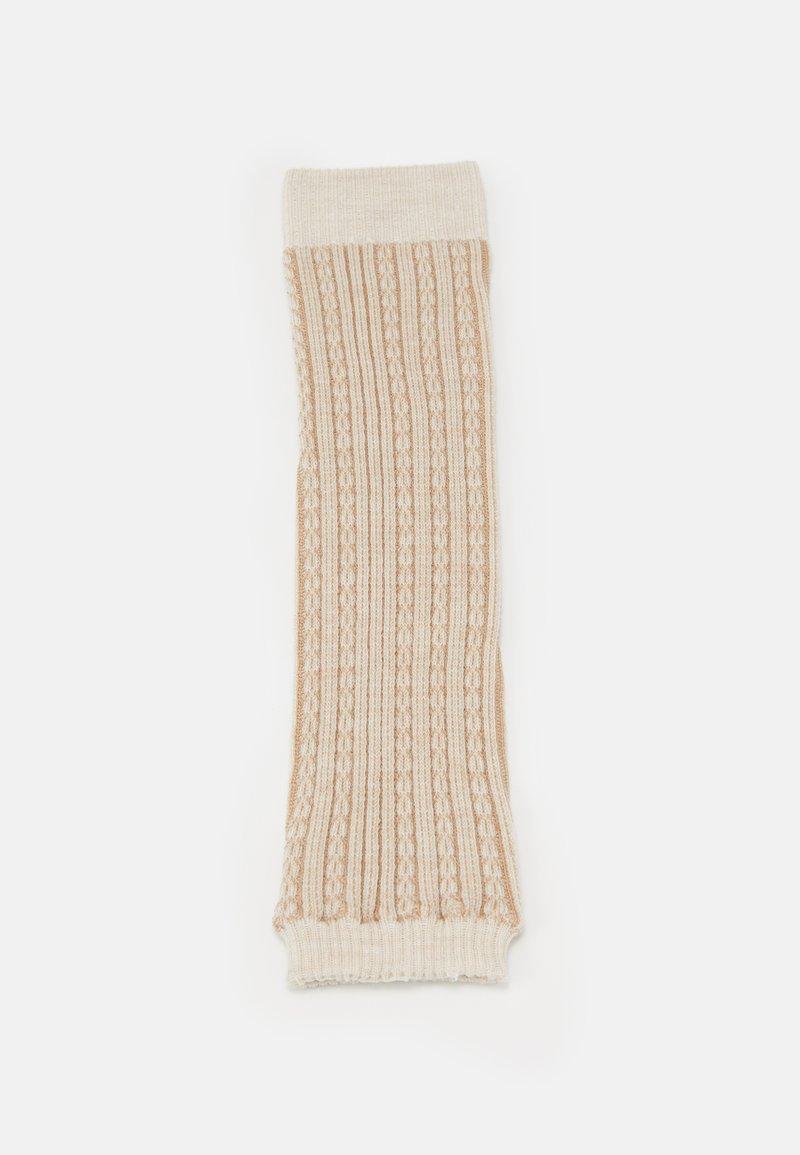 Falke - CHAIN STITCH - Leg warmers - beige