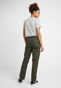 Carhartt WIP - CYMBAL PANT COLUMBIA - Trousers - cypress rinsed - 2