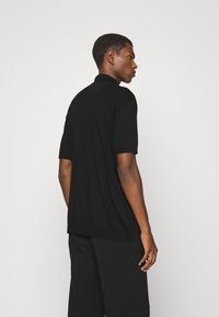 HUGO - DONHAM - Polo shirt - black - 2
