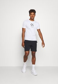 Calvin Klein Performance - SHORTS - Sports shorts - black - 1