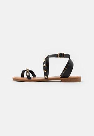 LEILA - T-bar sandals - black