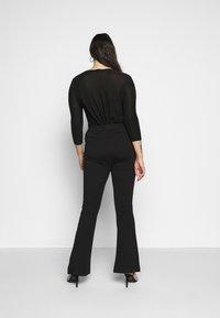 Vero Moda Curve - VMKAMMA FLARED PANT - Bukse - black - 2