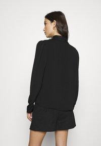 Vero Moda - VMWIGGA COLLAR - Button-down blouse - black - 2