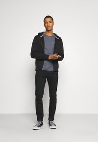 Tommy Jeans - SCANTON SLIM - Slim fit jeans - new black stretch - 1