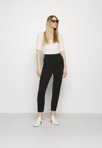 Marks & Spencer London - PLAIN TAP - Trousers - black - 1