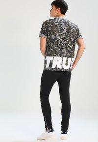 YOURTURN - Tracksuit bottoms - black - 2