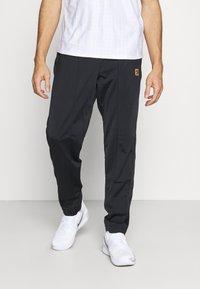 Nike Performance - HERITAGE SUIT PANT - Verryttelyhousut - black - 0