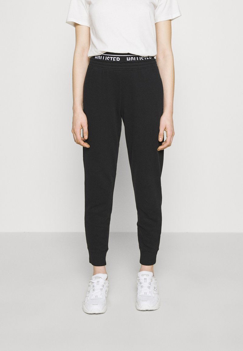Hollister Co. - LOGO  - Tracksuit bottoms - black