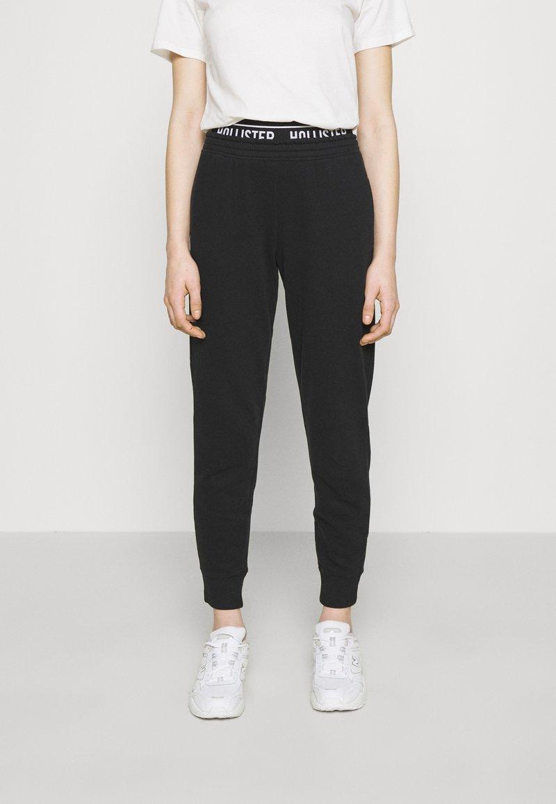 Hollister Co. - LOGO  - Teplákové kalhoty - black