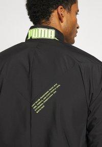 Puma - TRAIN FIRST MILE XTREME JACKET - Training jacket - black - 6