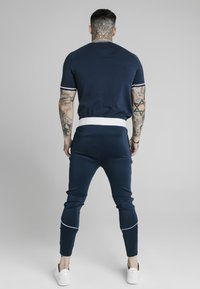 SIKSILK - SIGNATURE PIPED TECH TEE - Print T-shirt - navy