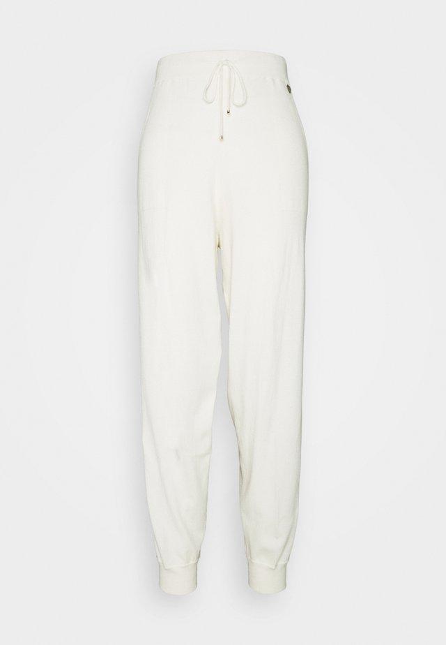 Tracksuit bottoms - bianco panna