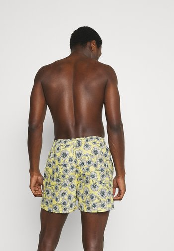 JJIBALI JJSWIMSHORTS FIELD FLOR - Swimming shorts - pale banana