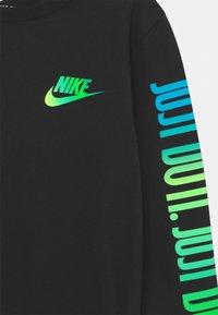Nike Sportswear - JUST DO IT - Long sleeved top - black - 2