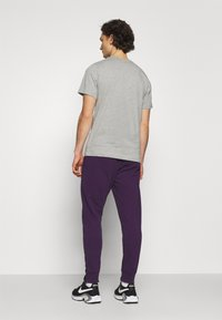 Nike Sportswear - CLUB - Tracksuit bottoms - grand purple/white - 2