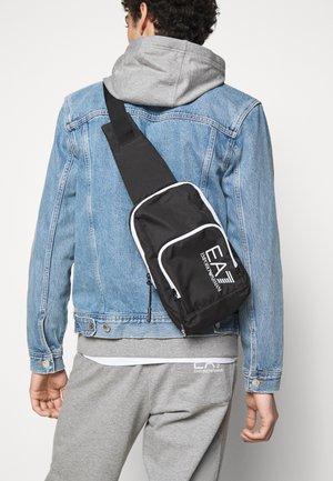 UNISEX - Across body bag - black/white