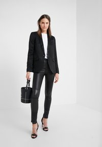 KARL LAGERFELD - PATENT BIKER PANTS - Leather trousers - black - 1