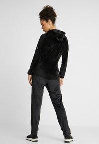 Luhta - ENANNIEMI - Spodnie treningowe - black - 2