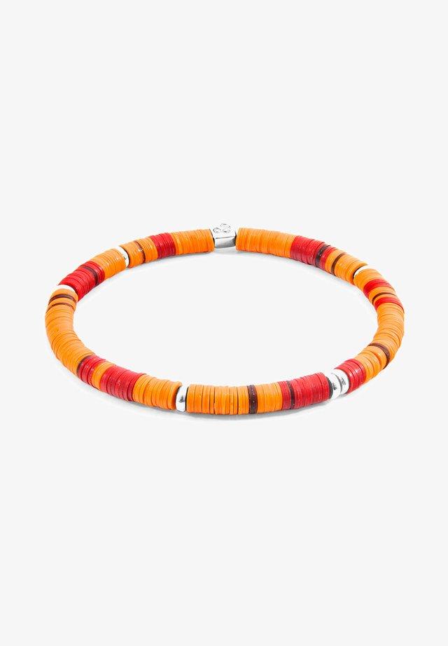DISC - Rannekoru - orange