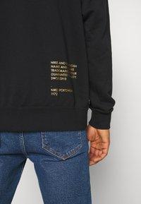 Nike Sportswear - HOODIE - Sudadera con cremallera - black/gold - 6