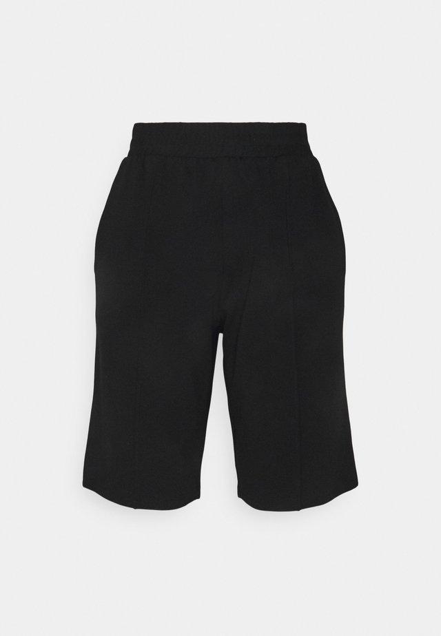 PCTARA BERMUDA - Shorts - black