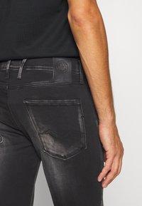 Replay - ANBASS HYPERFLEX BIO - Slim fit jeans - black - 6