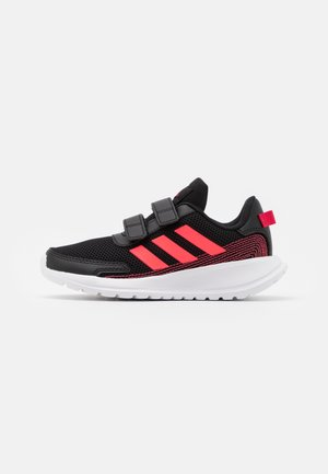 TENSAUR RUN UNISEX - Neutral running shoes - core black/signal pink/power pink